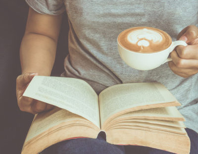 web3-woman-reading-book-coffee-home-shutterstock